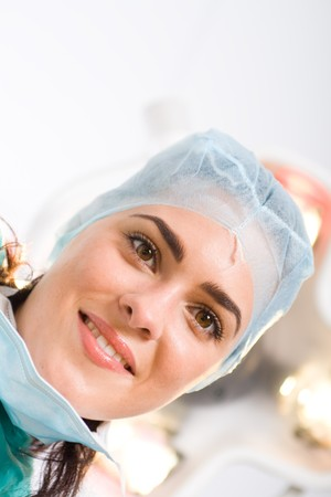 female doctor looking down at patient in operation room Stock Photo - 4411397