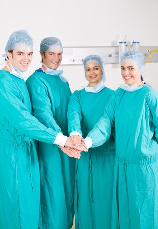 doctors with hands together to form a medical teamwork photo