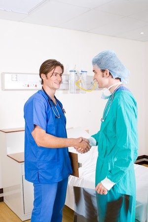two male doctor handshake photo