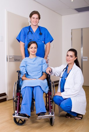 hospitalization: doctor, nurse and patient in hospital ward