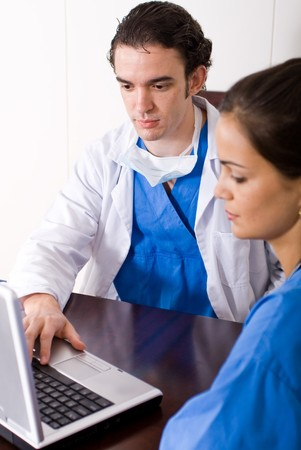 doctors using laptop doing work photo