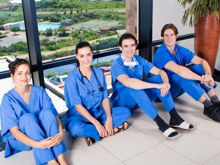 group of young doctors and nurses relaxing photo