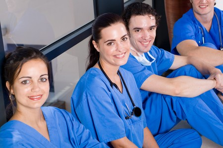 group of young doctors and nurses relaxing