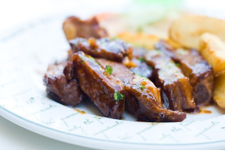 pork ribs and potato chips photo