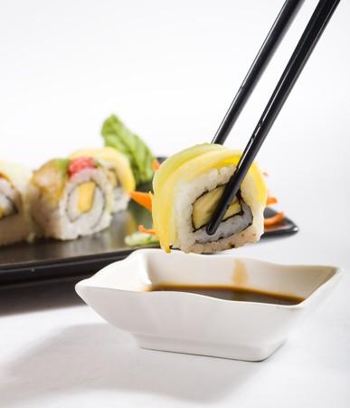 sushi dipping in vinegar photo