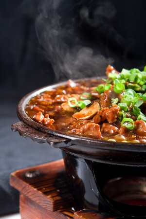 hot chinese cooking with steam photo