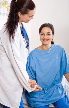 doctor helping patient from wheelchair photo