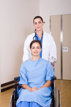 recuperating: patient in wheelchair with doctor