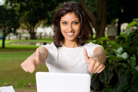 computer gaming: happy indian girl Stock Photo