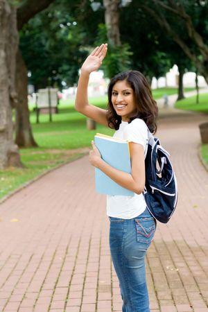 student waving photo