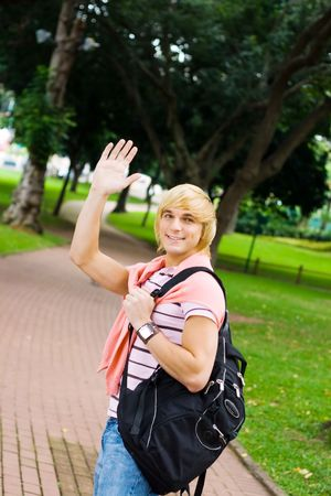 knowledgeable: student waving farewell Stock Photo