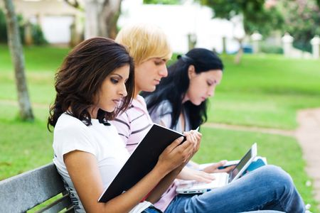 international people: group of students reading