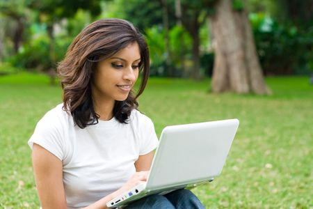 woman playing games on laptop photo
