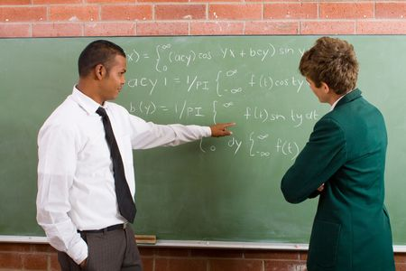 sums: teaching student maths problems Stock Photo