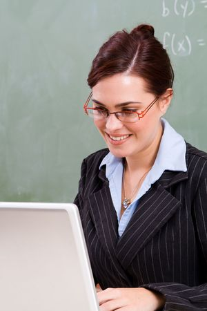 business attire teacher: teacher using laptop