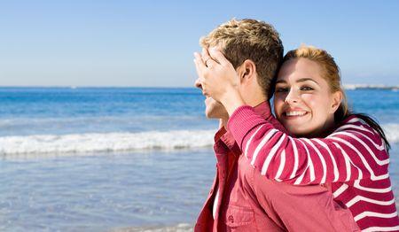 woman blindfolding her boyfriend photo