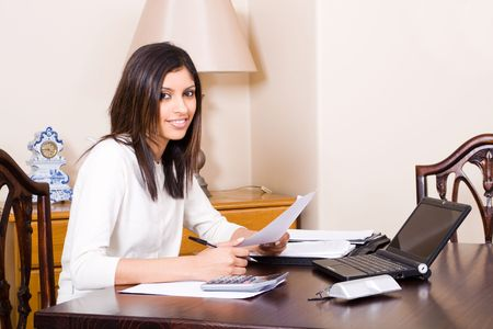 pay desk: beautiful woman doing finances at home