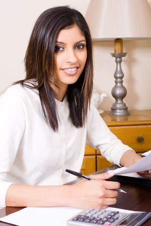 beautiful woman doing finances at home photo