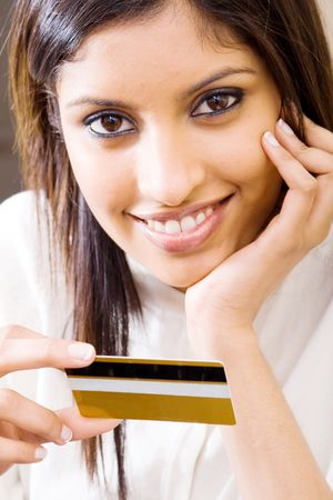 young beautiful woman holding a credit card and smiling Stock Photo - 5493097