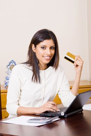 smart card: young woman holding credit card