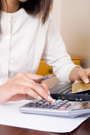 pay desk: woman checking credit card bills