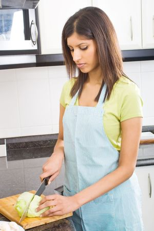 young housewife cooking food Stock Photo - 5493151