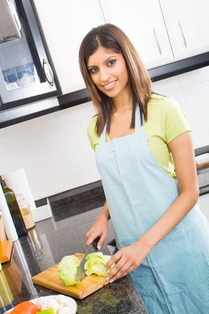 young housewife cooking food Stock Photo - 5493082
