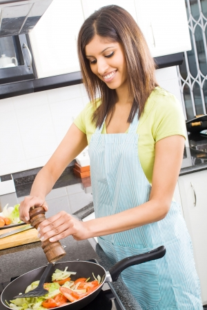 woman cooking: woman cooking at home kitchen