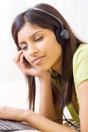 woman enjoying music photo