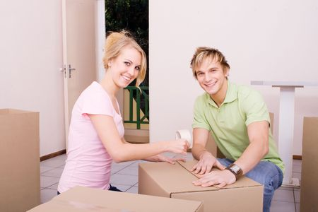 couple packing boxes photo