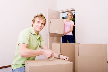 couple packing for new house photo