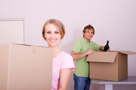 alcohol cardboard: couple packing for new home