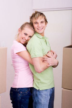happy young couple hugging in new home photo