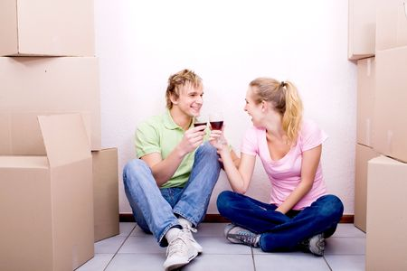 alcohol cardboard: young couple celebrate their new home