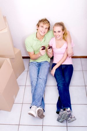 young couple celebrate their new home photo