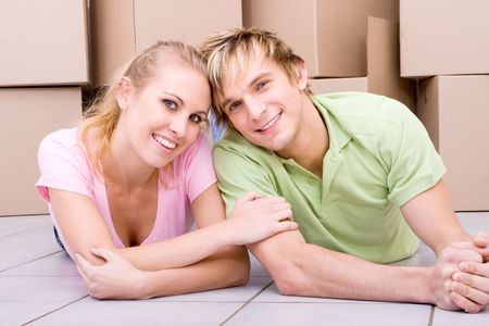 happy young couple move in together photo