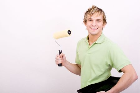 young man painting apartment photo