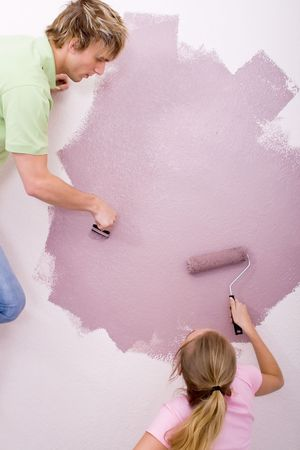 couple painting home photo