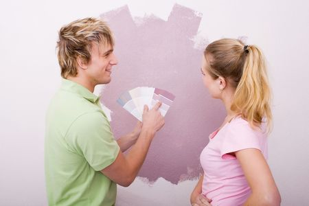 couple choosing new home color photo
