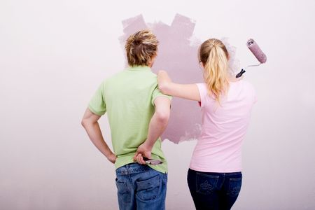 couple choosing painting color for new home photo