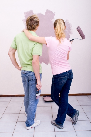 couple painting house photo