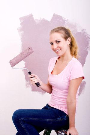 young woman painting home photo