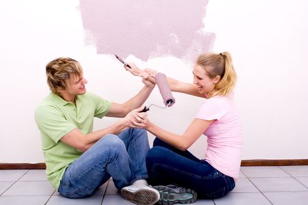 couple having fun while doing home improvement  photo