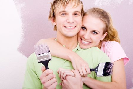 young couple doing home diy together photo