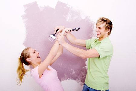 fun couple painting house Stock Photo - 5499892