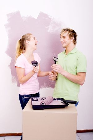 fun couple painting house photo
