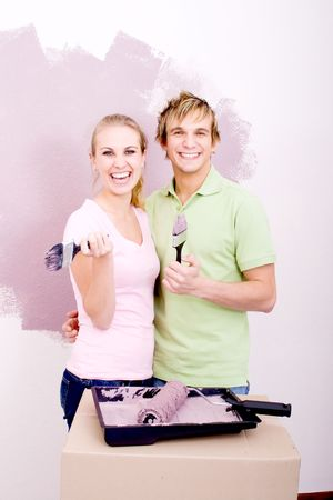 happy young couple doing home improvement photo