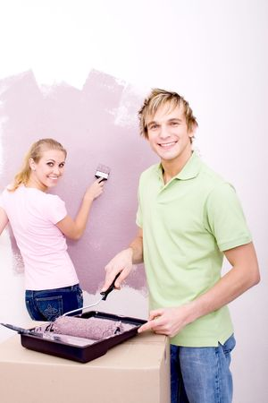couple painting apartment photo