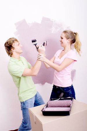happy young couple painting new home   photo