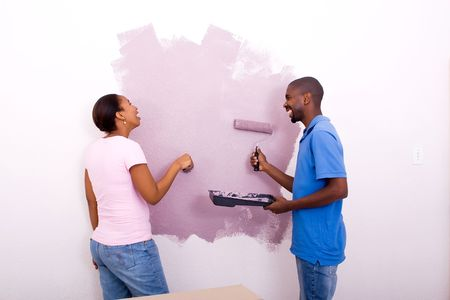 happy african couple painting home photo